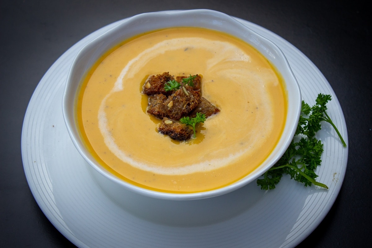 bowl of butternut squash soup on plate
