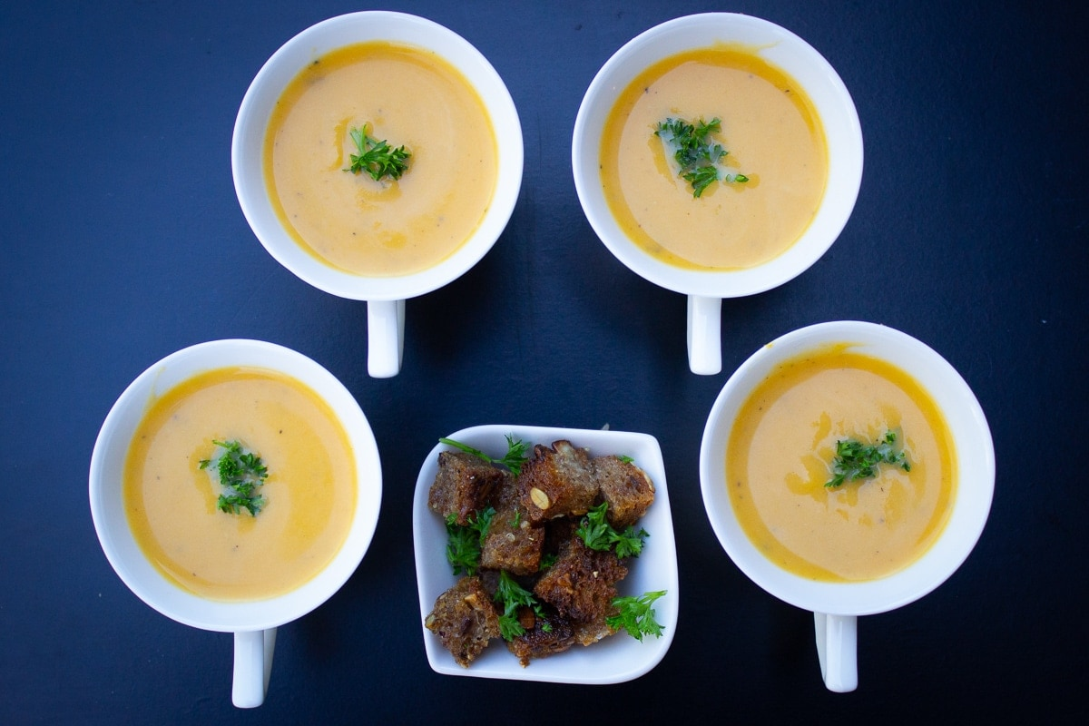 butternut squash soup in 4 espresso cups with bowl of croutons