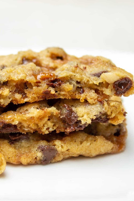 stacked chocolate chip toffee cookies broken in half