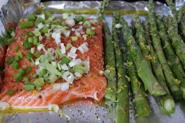 Salmon and asparagus ready for roasting