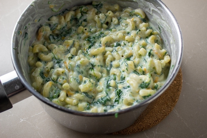 macaroni spinach and cheese sauce combined in pot