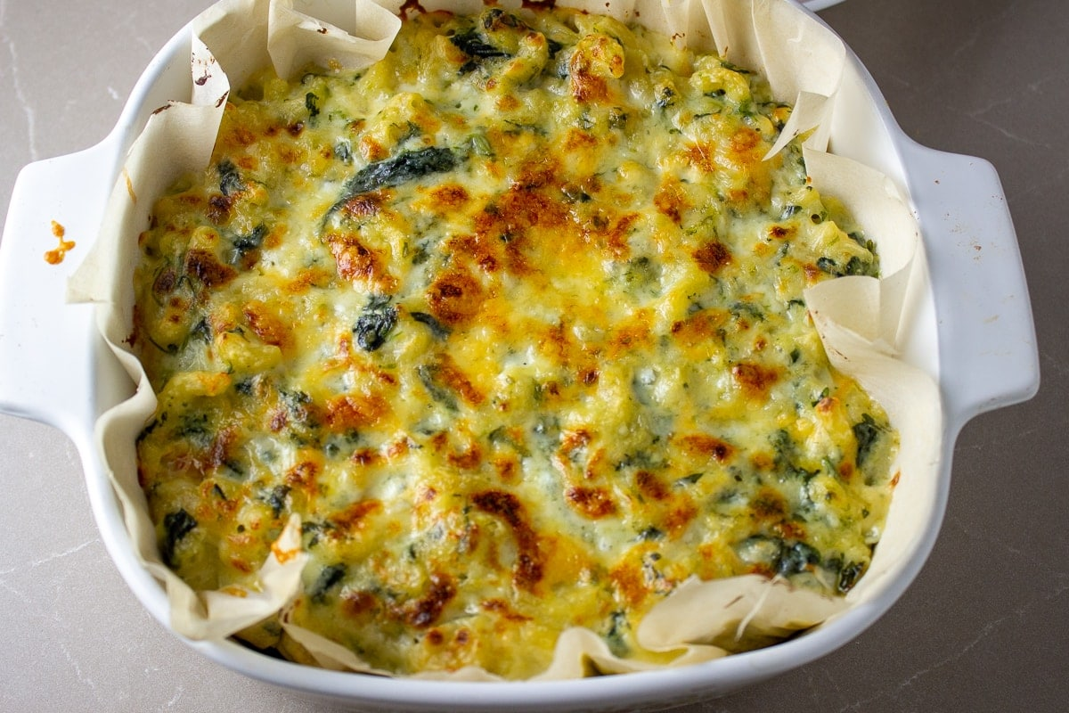baked spinach mac and cheese in casserole dish