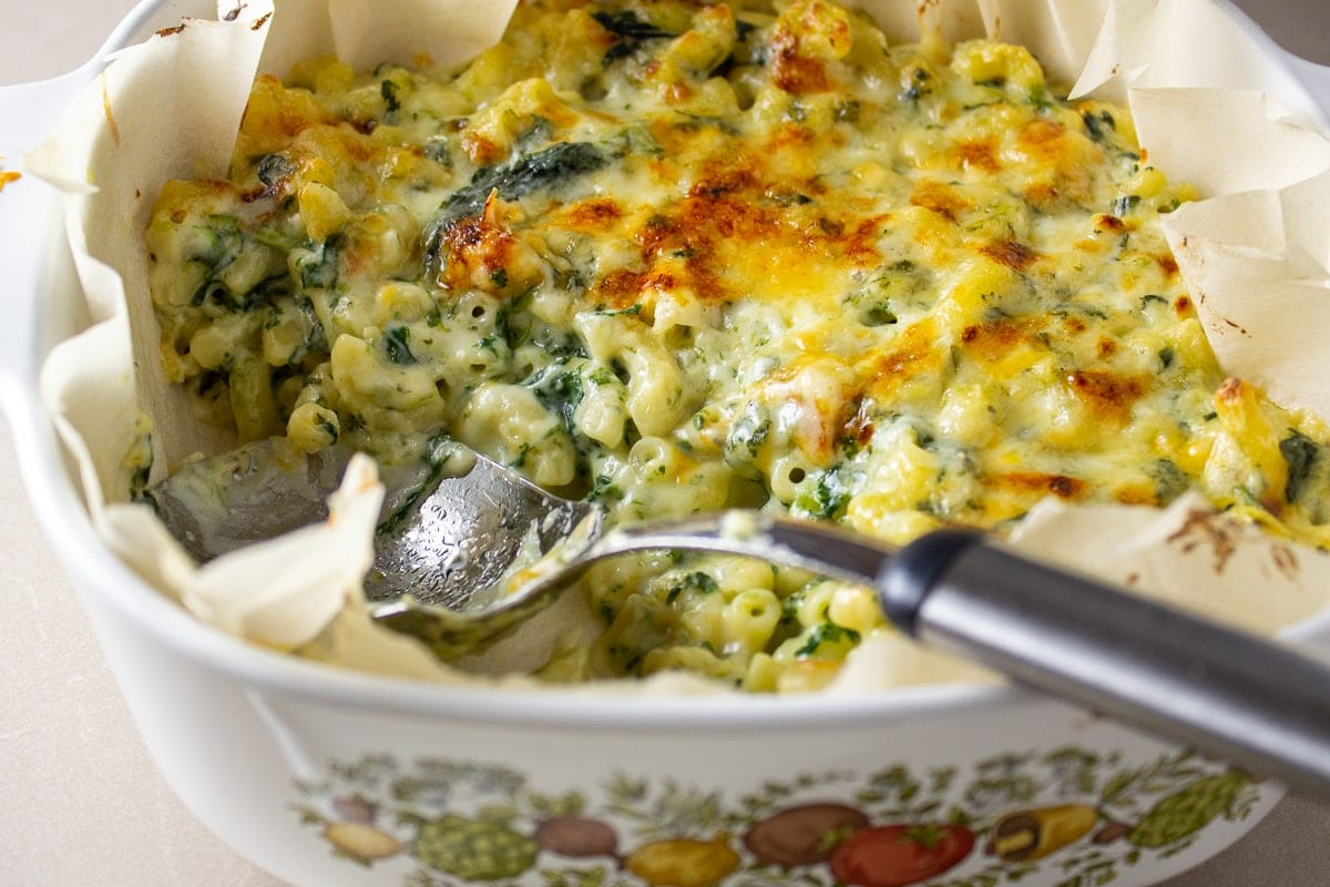 baked spinach mac and cheese in casserole dish 1