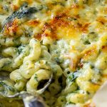 scoop of Spinach Mac and Cheese in casserole