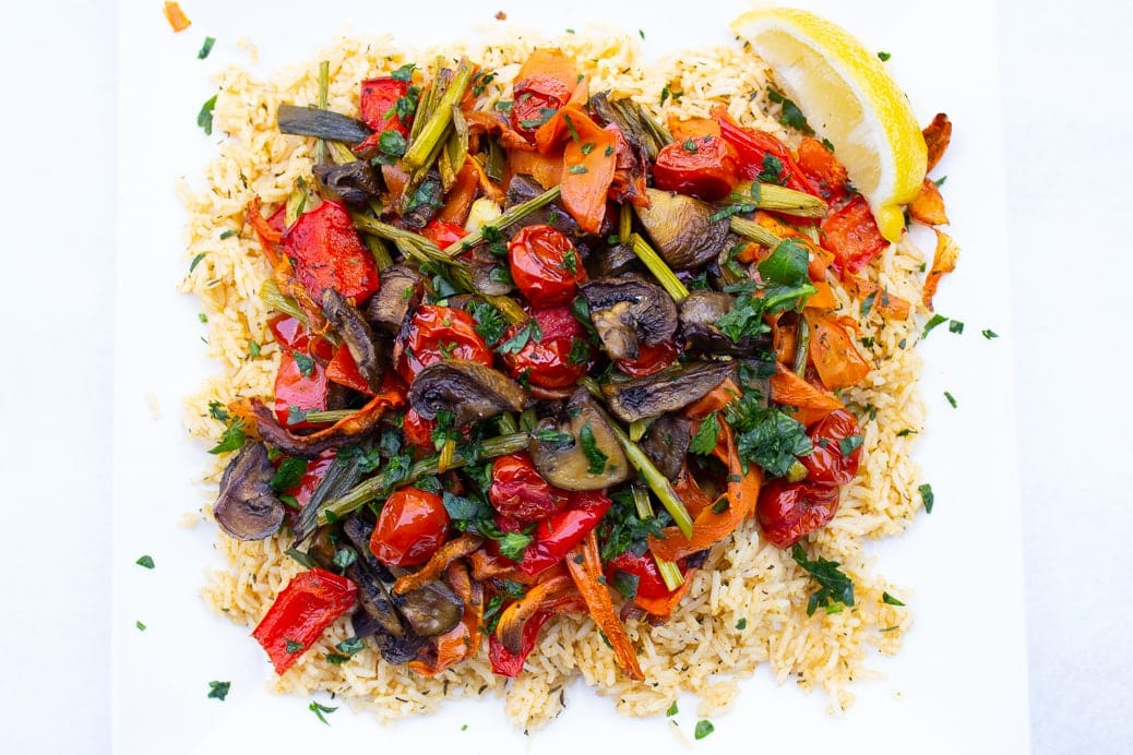 savoury rice and roasted veggies on a plate looking from above