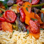Roasted Veggies on top of Spiced Rice on a plate p