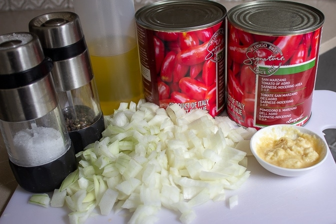 chopped onions, minced garlic, 2 cans san marzano tomatoes, oil, salt pepper