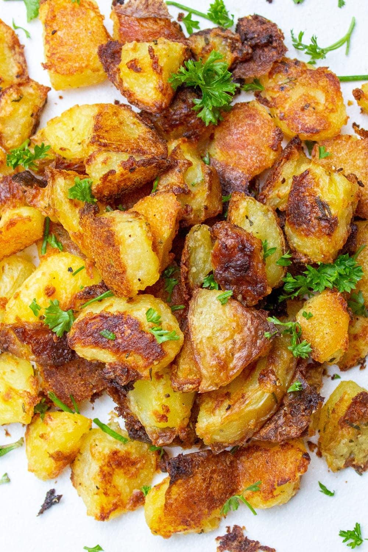 roasted potatoes piled on plate
