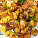 Crispy Oven-Roasted Potatoes piled on a plate fff