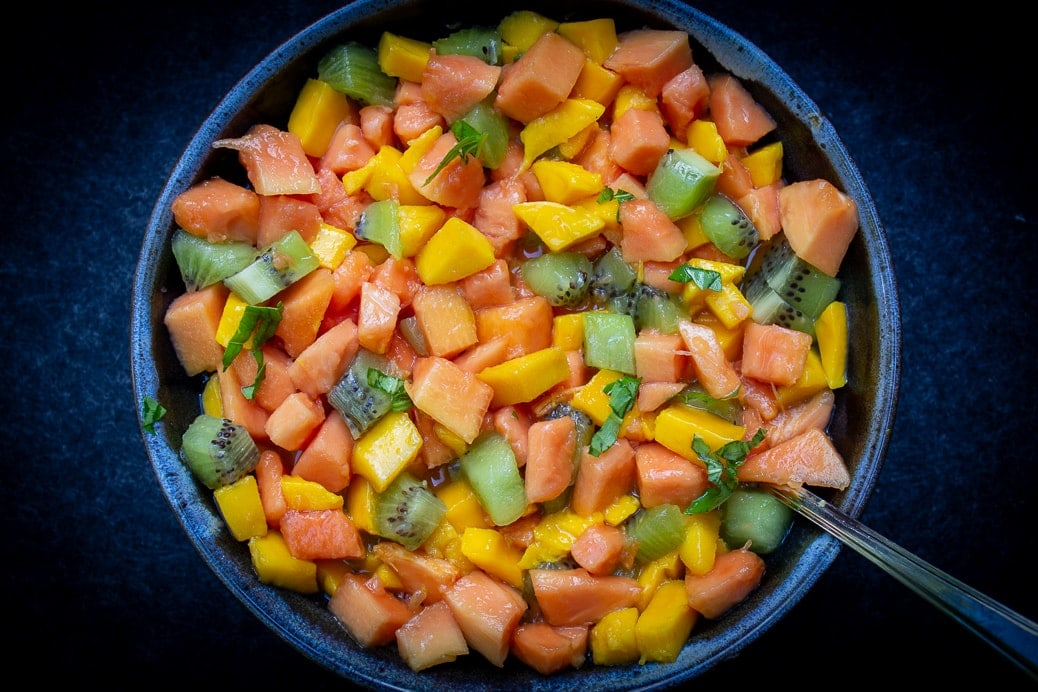 Tropical Fruit Salad with mango, kiwi and papaya in a bowl