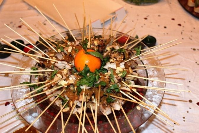 On buffet table presented on skewers