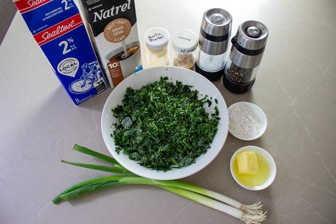 frozen spinach, butter, oil, flour, salt, pepper, garlic powder, nutmeg, milk, cream