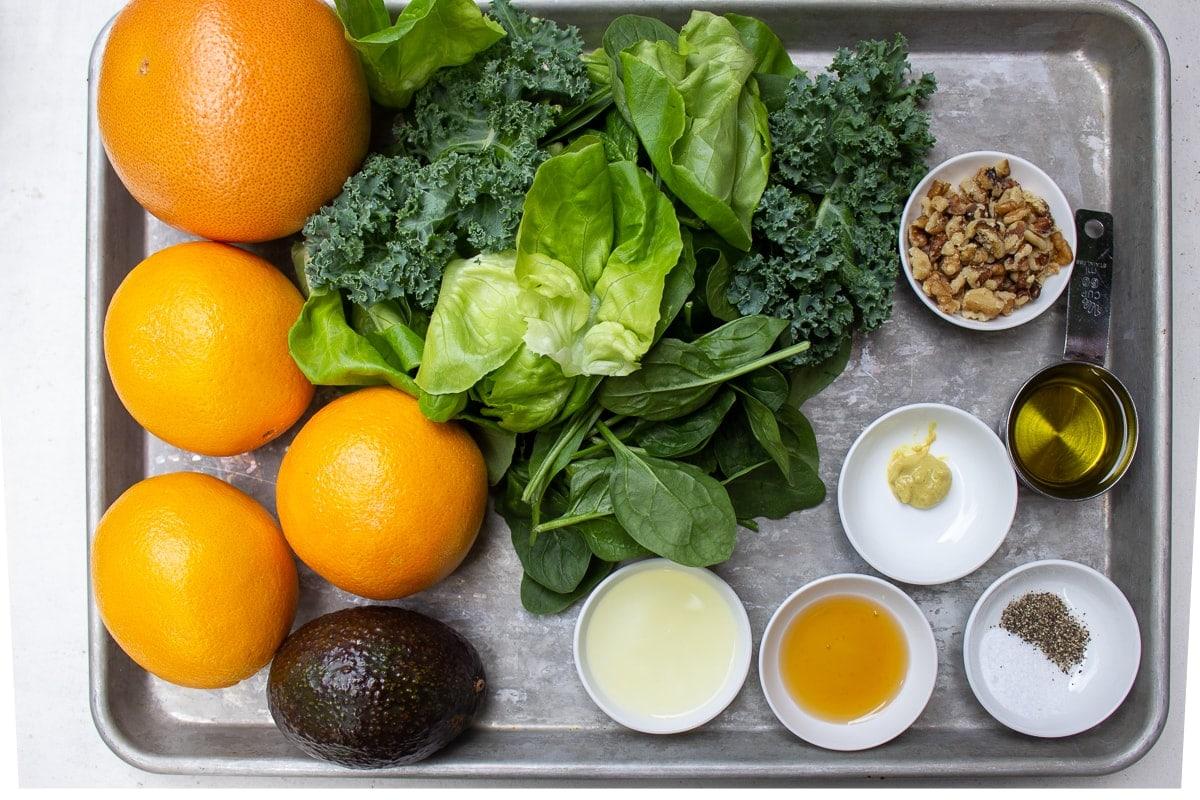 oranges, grapefruits, greens, avocado, vinaigrette ingredients, nuts