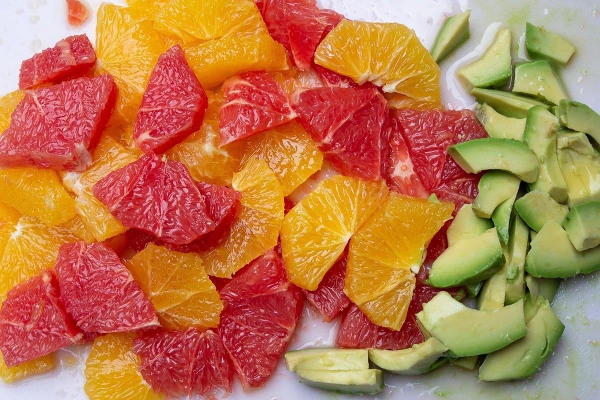 sliced citrus fruit and avocado