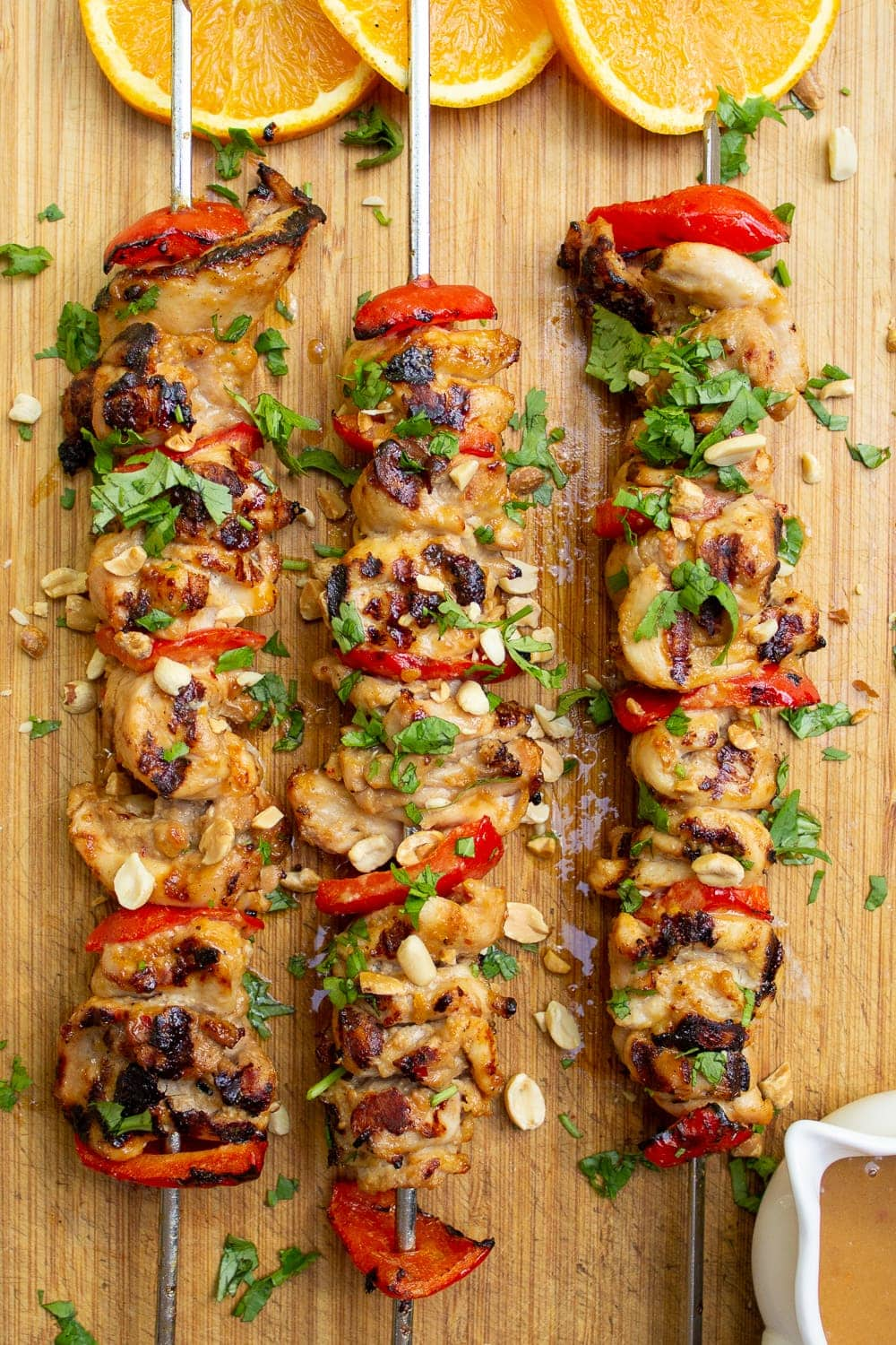 cooked chicken skewers on cutting board p3