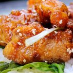 Honey Garlic Chicken laid on rice on a plate
