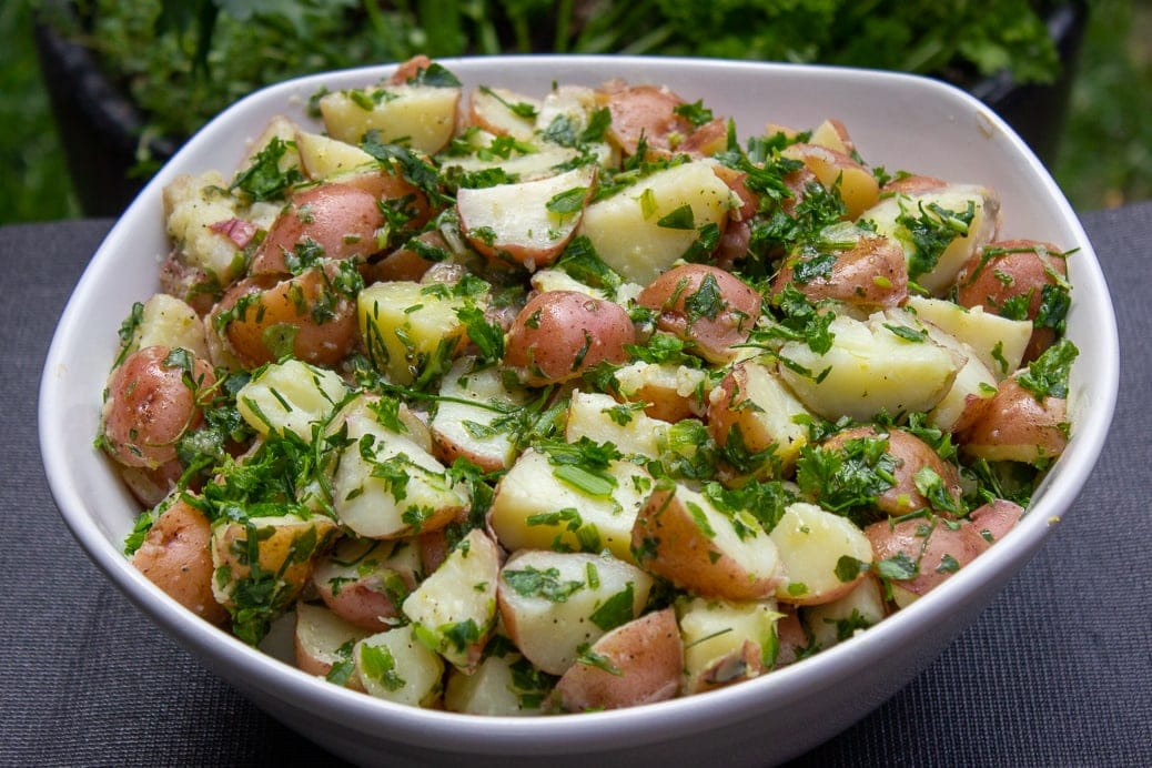 Herb Potato Salad in bowl on tray in garden2