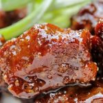 Honey garlic beef on a plate with scallions pp