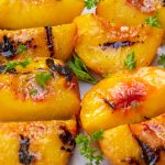 quartered grilled peaches on plate p