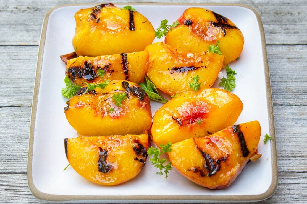 grilled quarter peaches on a plate