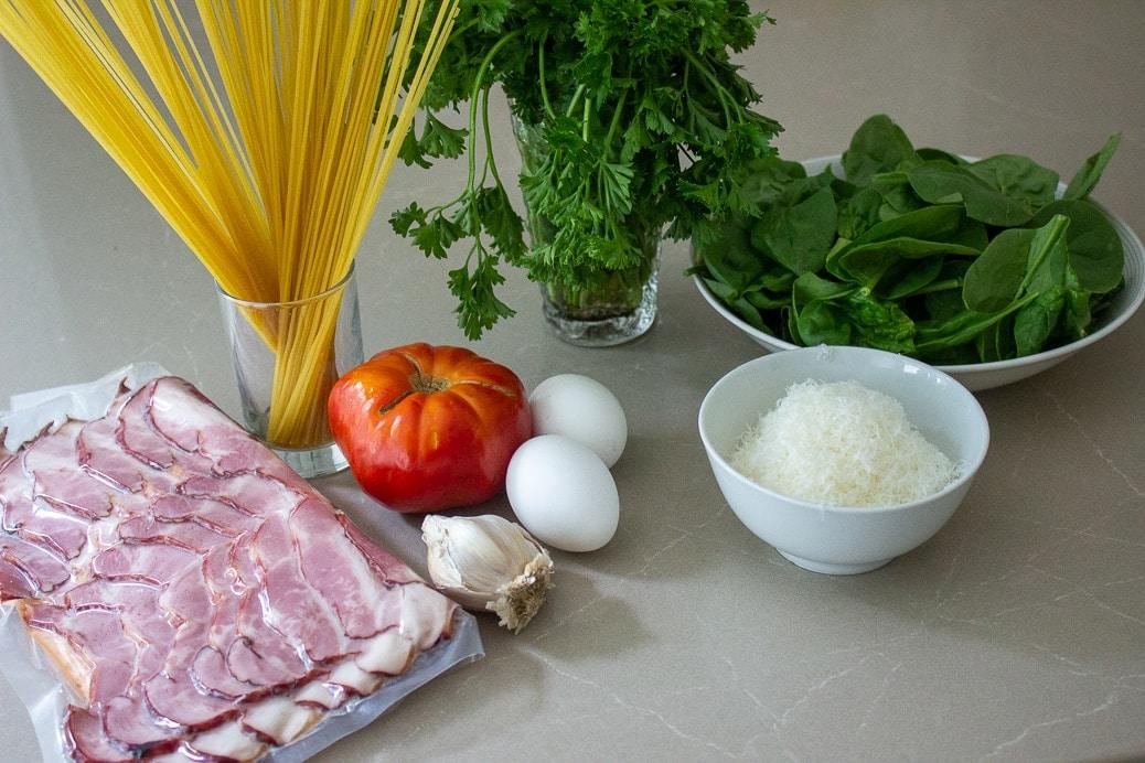 spaghetti, bacon, tomato, eggs, garlic, parmesan, spinach, parsley