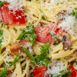 spaghetti carbonara with tomatoes and spinach in bowl p4