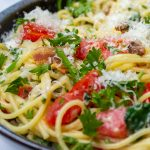 spaghetti carbonara with tomatoes and spinach in bowl p6