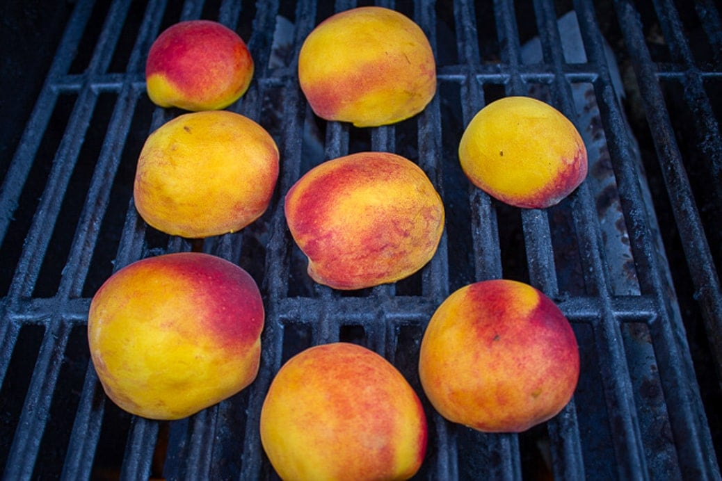 peach halves face down on grill