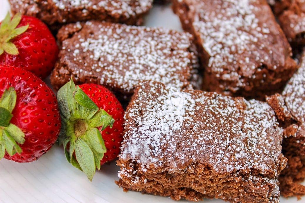 8 Minute Fudgy Brownies on plate with strawberries