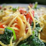 spaghetti carbonara with tomatoes and spinach in bowl p7