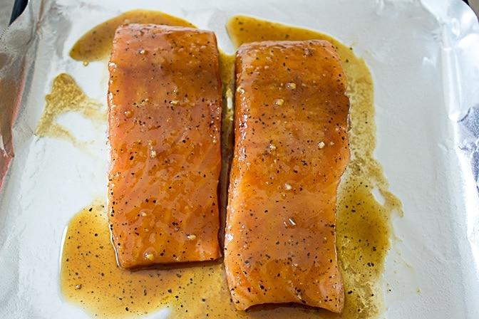 marinated salmon on pan ready to roast