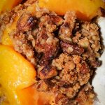 Peach Crumble in a bowl with vanilla ice cream p2