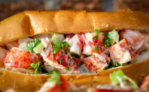 lobster roll on plate close up