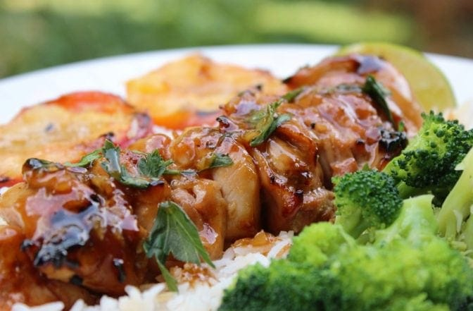 Spicy Honey-Lime Chicken skewers are a bed of rice with broccoli