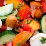 Peach panzanella salad in bowl p1