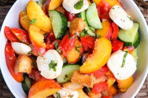 Peach panzanella salad in bowl