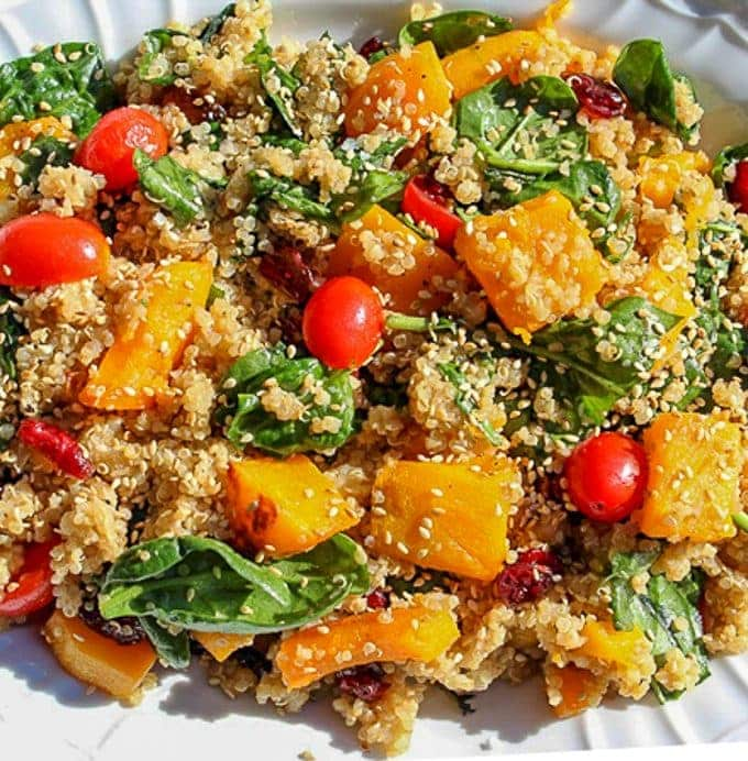 Quinoa and Butternut Squash salad in white serving bowl garnished with sesame seeds