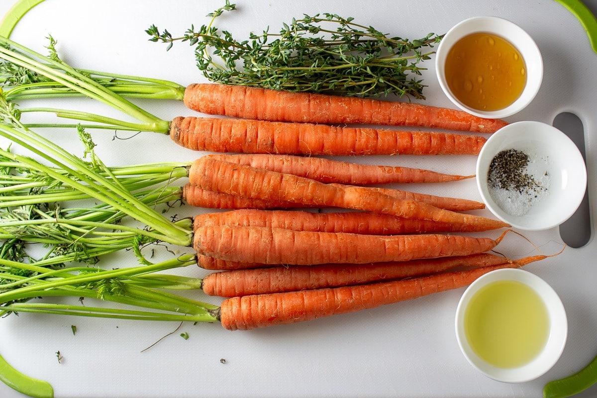 bunch of fresh carrots, fresh thyme, honey, oil, salt
