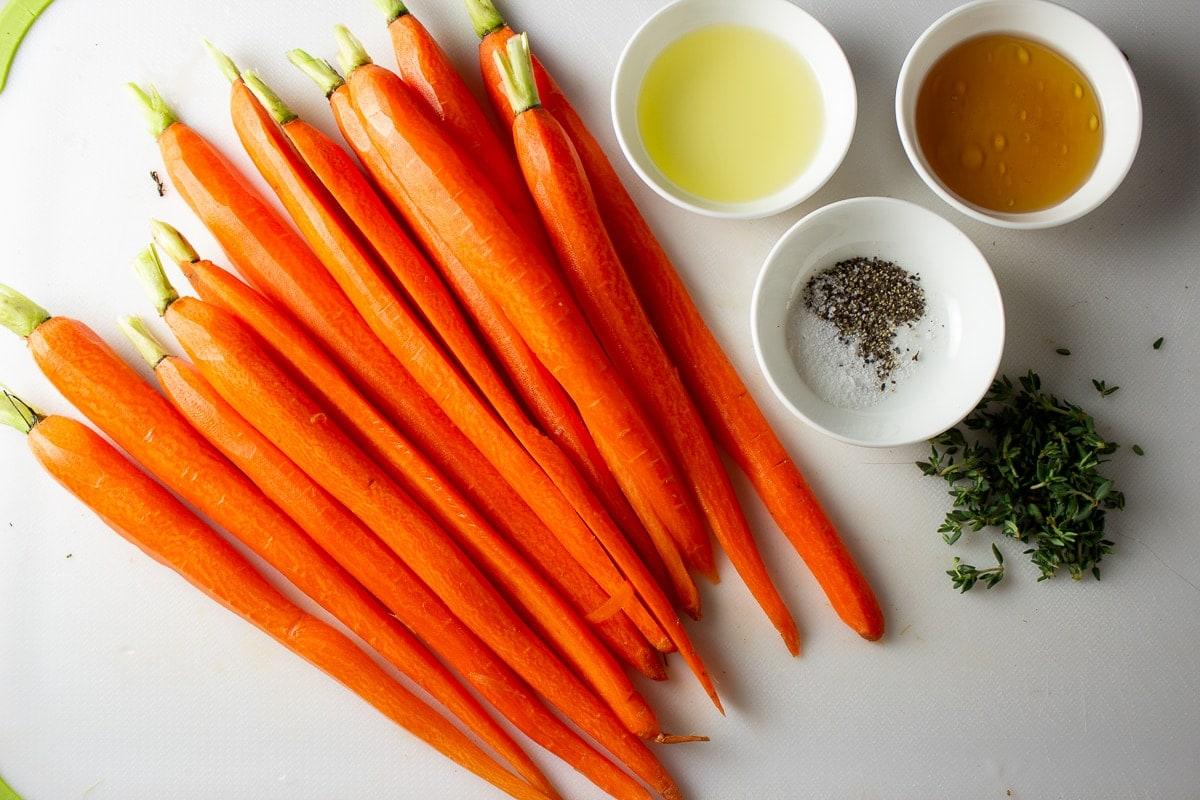 peeled carrots, oil, honey, thyme, salt pepper