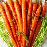 roasted honey glazed carrots on plate with orange zest