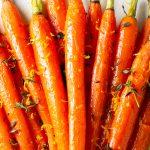 roasted honey glazed carrots on plate with orange zest p1