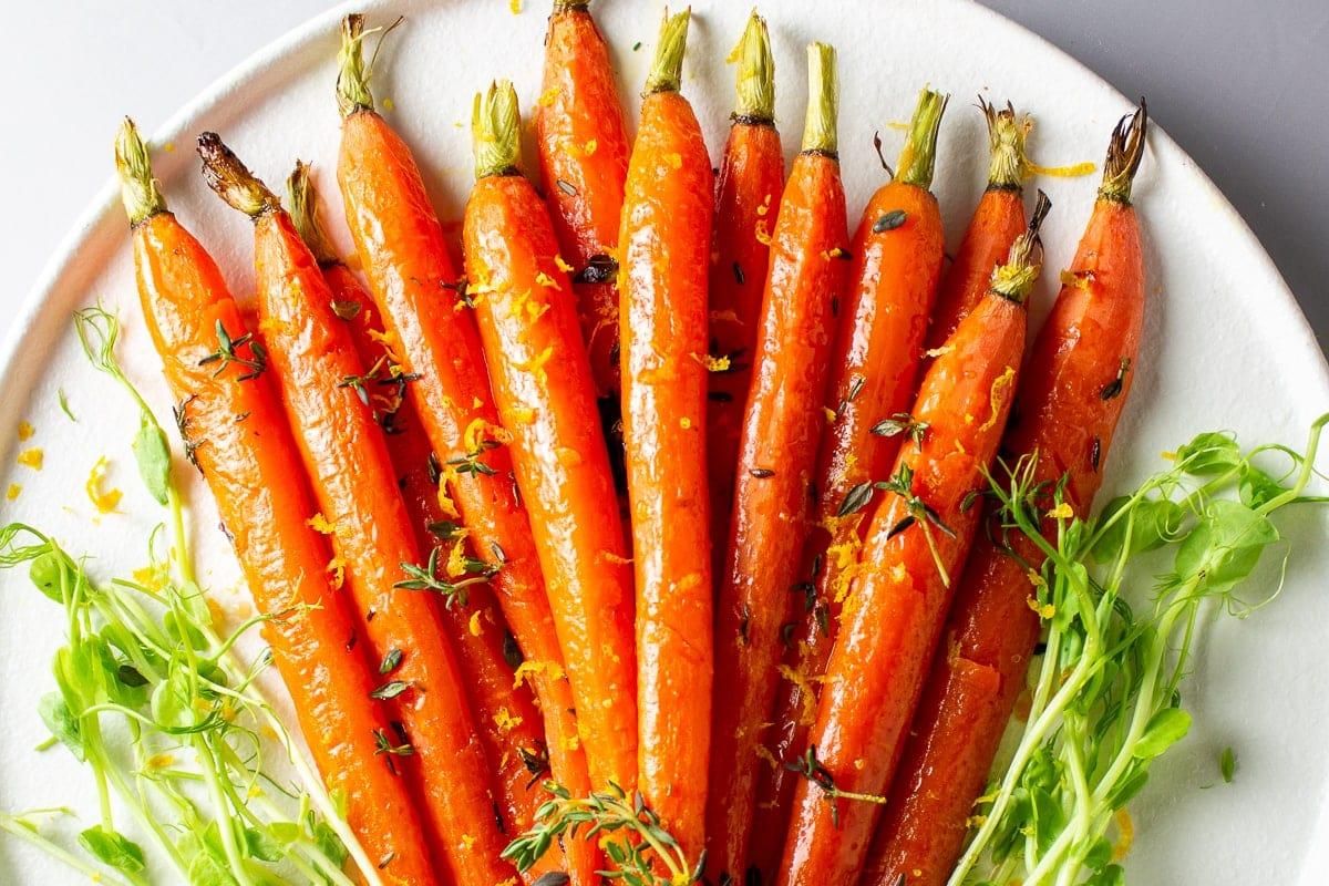 roasted honey glazed carrots on plate with orange zest 1