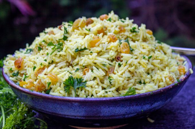 Curried Rice with Raisins in serving bowl