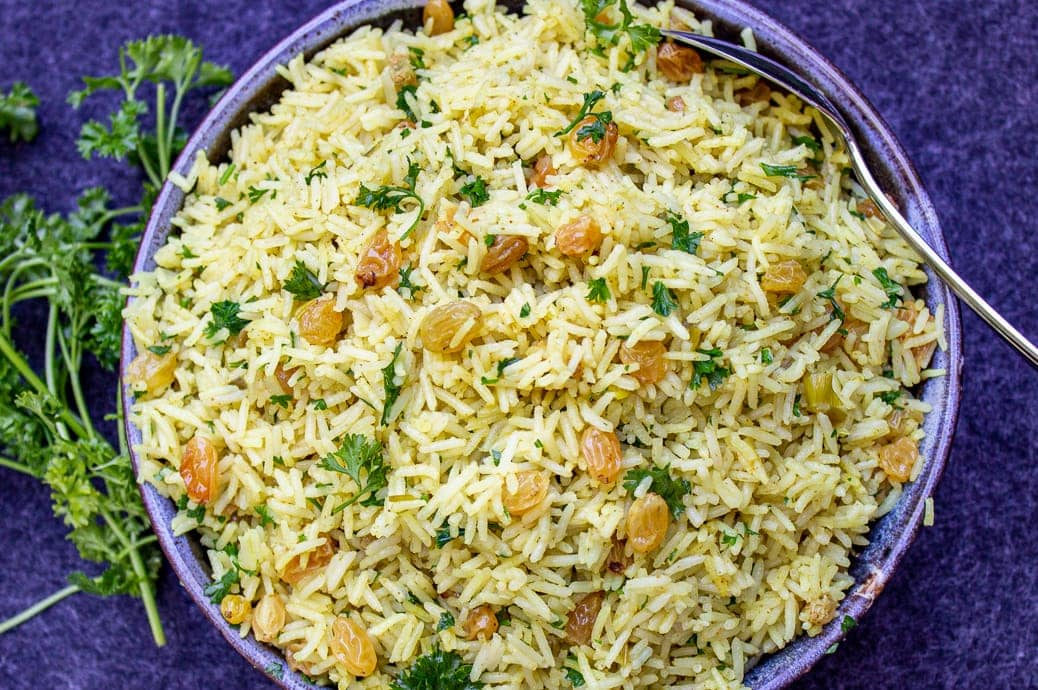 curried rice with raisins in bowl
