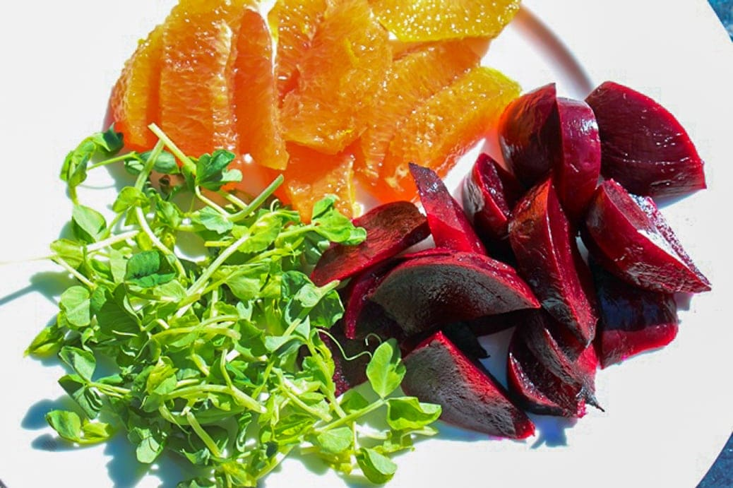 Beets, oranges, pea sprouts