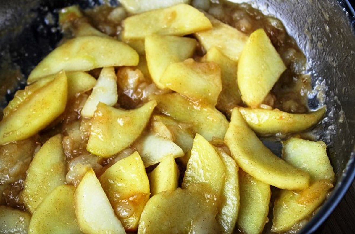 sauteed apples and pears with brown sugar and butter in pan