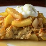 piece of apple french toast casserole on plate with sour cream on top