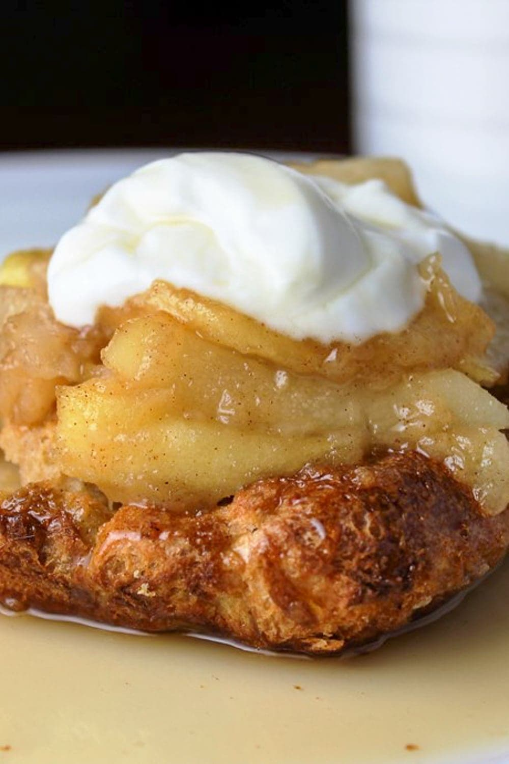 piece of french toast casserole with syrup and yogurt on plate p