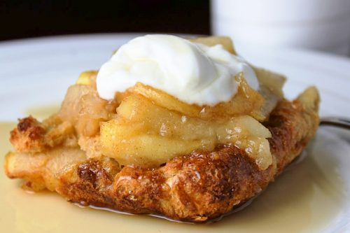 piece of french toast casserole on plate with yogurt and syrup ff