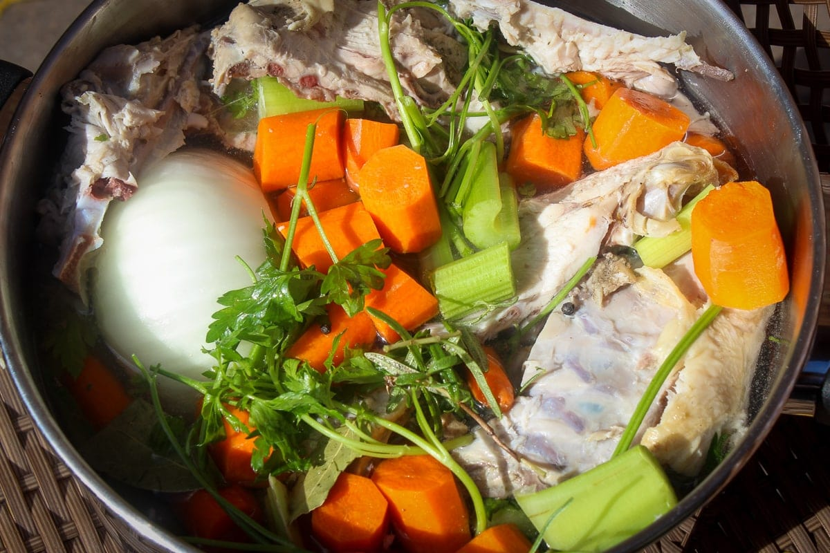 turkey bones, onion, vegetables, herbs, broth in soup pot